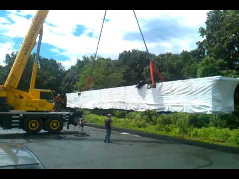 A 84' long stainless steel Bulkhead being picked up by a crane.