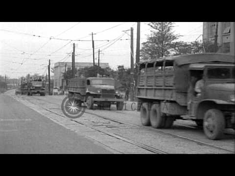 US Army convoy passes by a road and Japanese treasure unloaded at a warehouse in ...HD Stock Footage