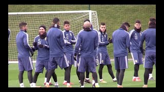 Argentina squad greet Messi with hugs on his return to training