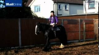 Teen loses both legs to meningitis but returns to horse riding