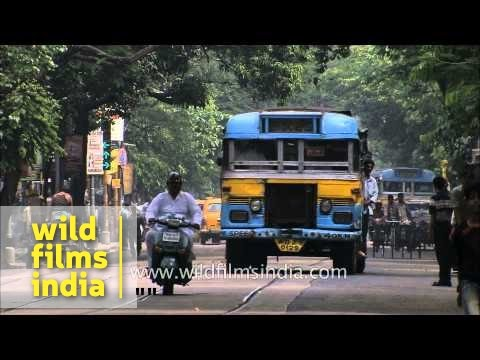 Buses, trams, taxis on the roads of Kolkata
