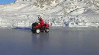 Quad bike drifting on Antarctic sea ice