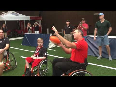 Tristan Phillips teaches UGA legends how to play wheelchair football