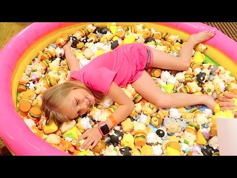 GIRL SWIMS IN SQUISHY TOY POOL!