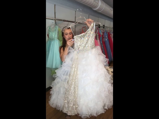 c95b4f24992 Read more Michelle s has a great assortment of little girls pageant dresses!  We also have the accessories to go with those dresses! Come in and see us!