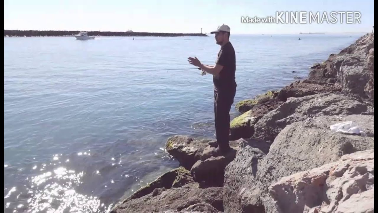 Fishing at the jetty seal beach rocks youtube for Fishing in orange county