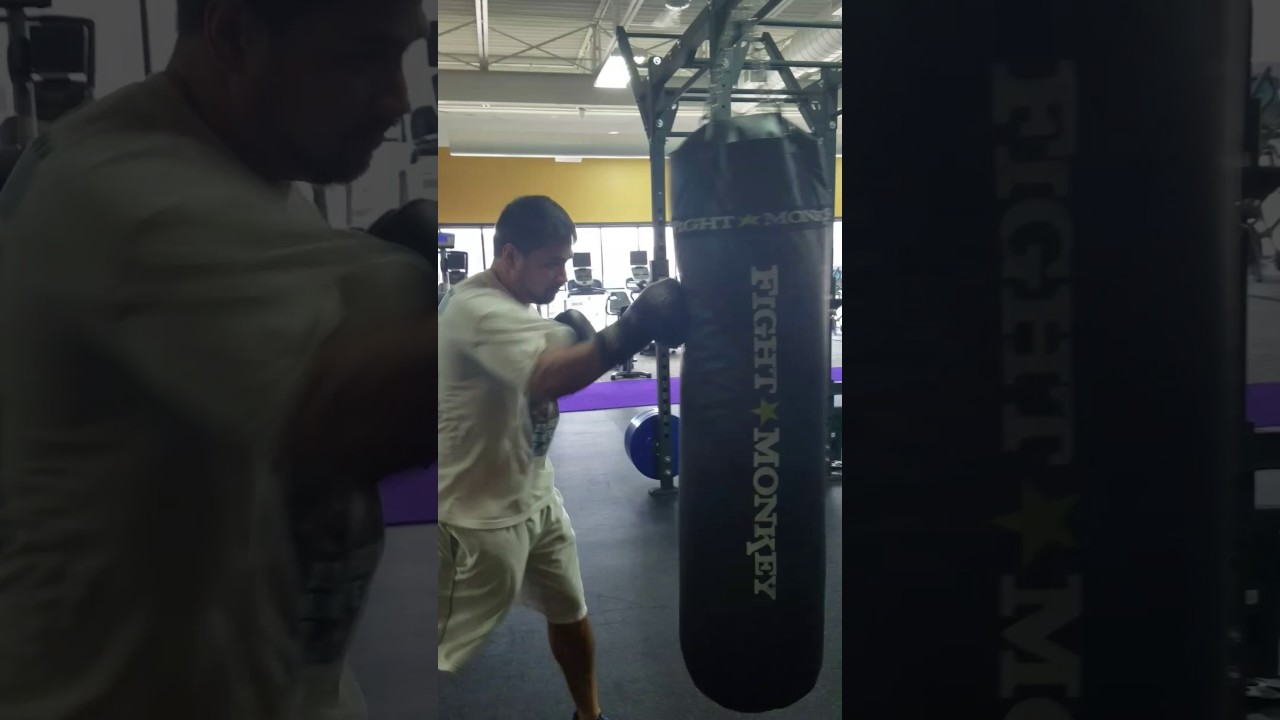 How To Hit A 200 Pound Heavy Bag And Use Combo Hooks