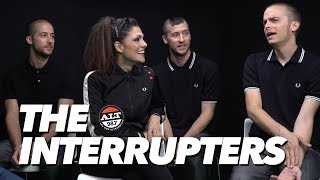 The Interrupters On Working With Tim Armstrong, The Warp Tour, 'Fight The Good Fight' & More