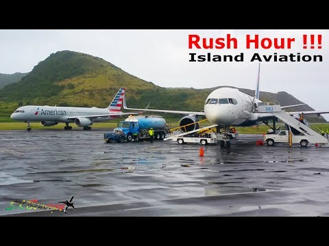 Rush Hour !!! Wet Ramp View.. AA 757, AA 738, DA 757, UA 738...action @ St. Kitts Airport