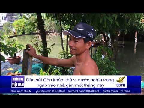 PHÓNG SỰ VIỆT NAM: Dân Sài Gòn khốn khổ vì nước từ nghĩa trang ngập vào nhà