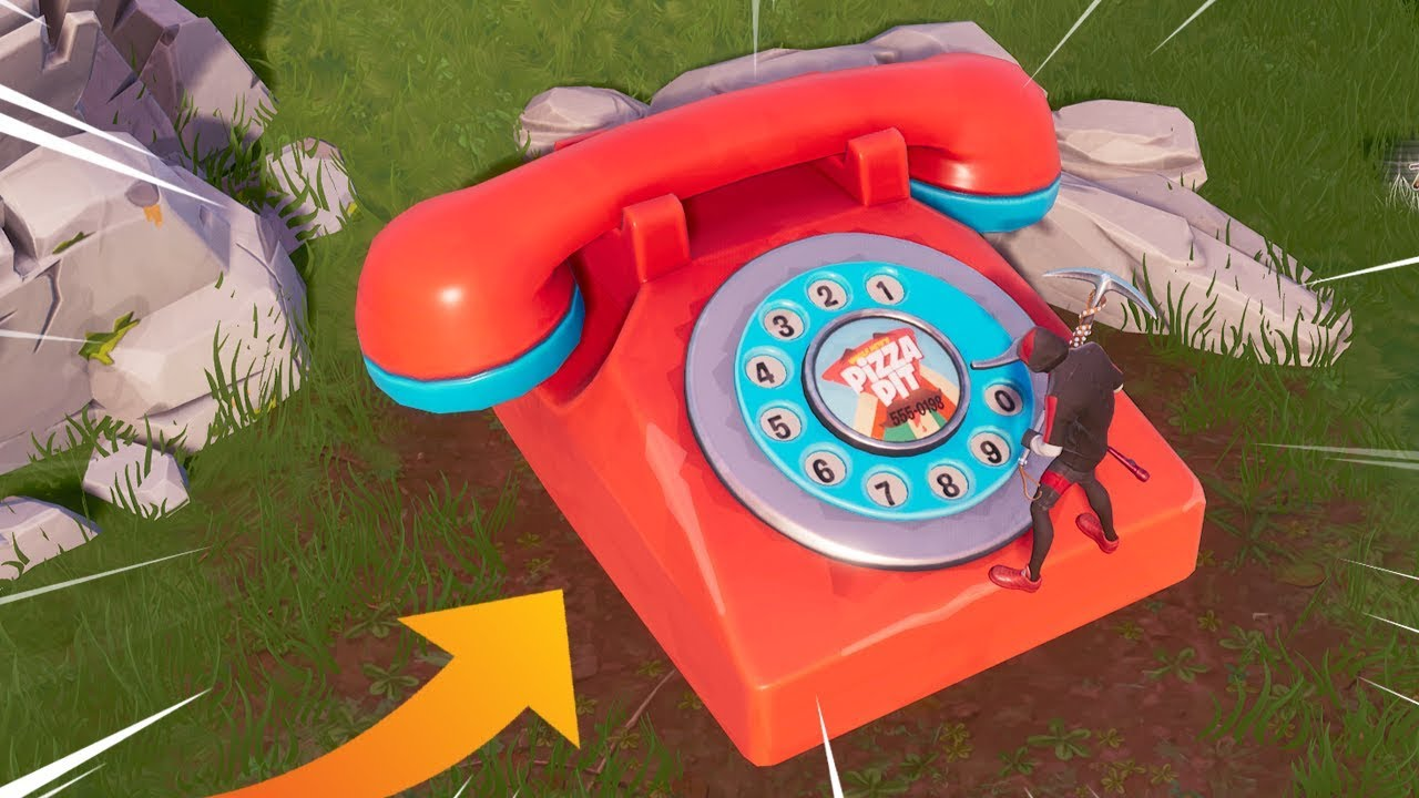 fortnite dial the pizza pit number on the big telephone east of the block location - big red phone fortnite