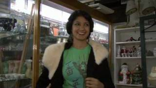 Ami checks out an antiques store close to the loft where the live footage was taped.