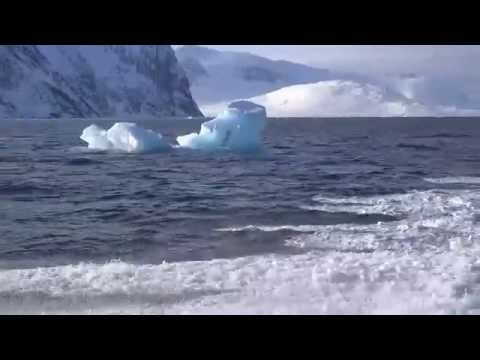 Sailing By Lonely Iceberg In Greenland