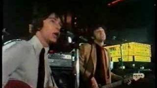 The Laughing Dogs in Times Square - Get
