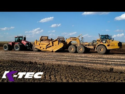 Case Tractor Pushing ADT To Load 63 Cubic Yard Scraper