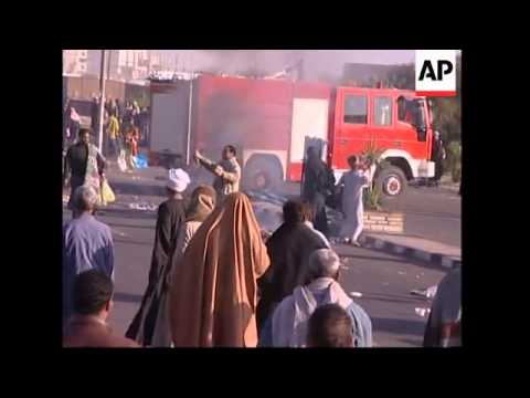 Crowds set fires in protest, throw stones at riot police, teargas