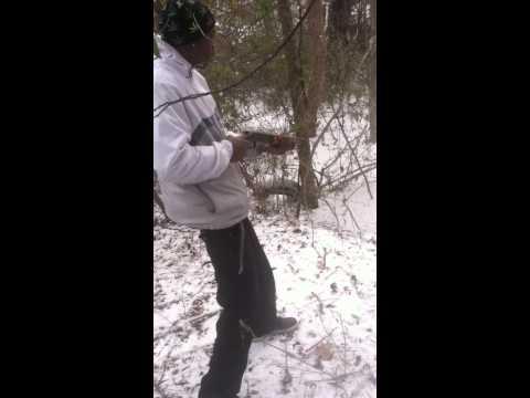 Guy shoots sawed off shotgun too high despite his buddy's warning