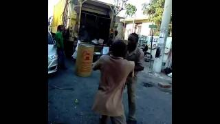 Garbage men fighting for 20 Jamaican dollars