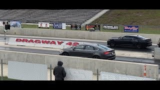 Ford Fusion Sport drag races Camaro SS, 2010 BMW M5 and a Mustang GT