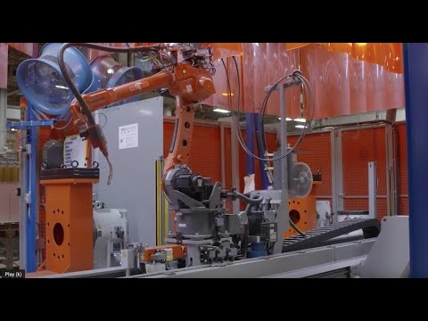 Robots And Humans Welding Together In Tulsa, Oklahoma