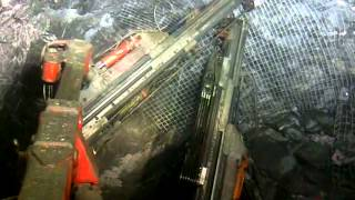 Bolting and Meshing an underground mine heading.