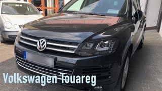 Volkswagen Touareg 3.0 с перекрашенным кузовом.