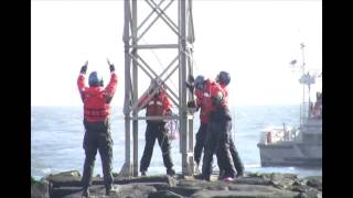 Coast Guard crews install aids to navigation