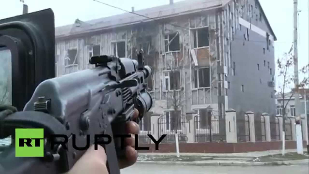 ROCKET LAUNCHERS fired on Chechen militants in occupied school