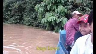 Travelling by Long Boat along Kanowit river.