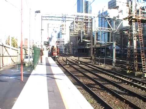 K153  Pulling into Flinders Street station platform 10 with K190 trailing
