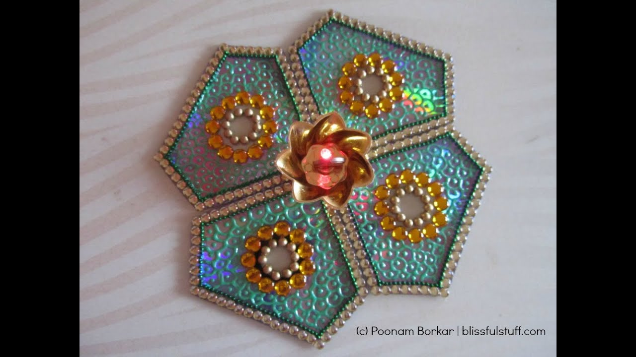 Diy cd rangoli how to make kundan rangoli with old cds for Best use of waste