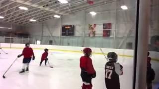 Jack playing hockey mighty mites 2012