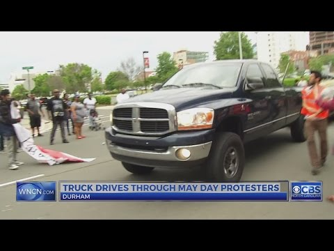 Pickup truck driver goes through Durham protest