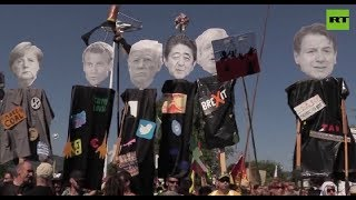 Thousands protest against G7 summit over group's economic policies