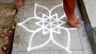 how to put flower rangoli