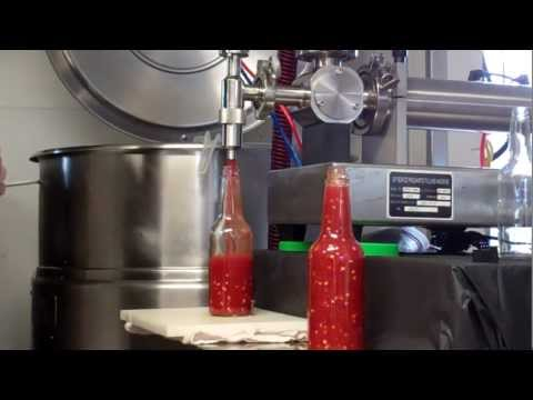 Hot Sauce Being Made And Bottled From The Hot Sauce Masters.