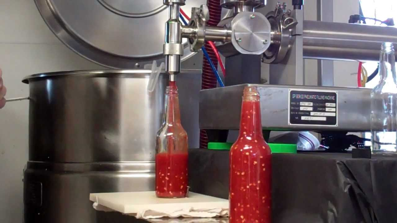 Hot Sauce Being Made And Bottled From The Hot Sauce Masters