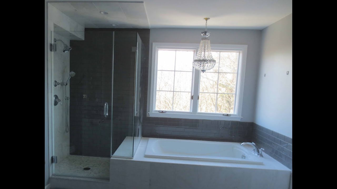 Complete bathroom install subway glass tile and Carrera marble tile ...