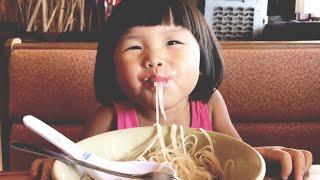 CUTE KID EATS PHO