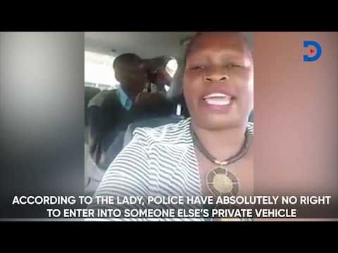 Motorist in a heated exchange with police officer who entered her car; what the law says...