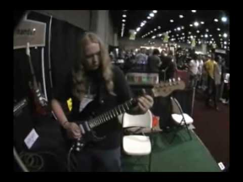 Travis Tidwell takes the Big Lou Wide Nut electric guitar for a spin