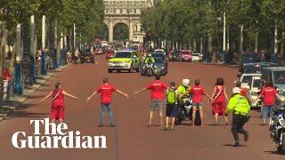 Greenpeace protesters disrupt Boris Johnson's arrival at Buckingham Palace