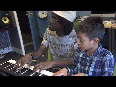 Blind piano teacher inspiring others with his gift of music