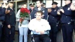 Raw Video: Shot cops leave hospital - New York Post