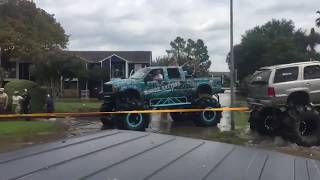 Rednecks In Houston TX Use Monster Truck To Pull A Military Truck From Deep Water