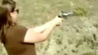 Woman takes gun recoil to face