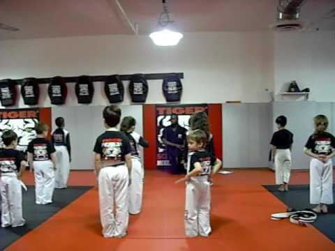Eitan receiving his yellow belt in karate class