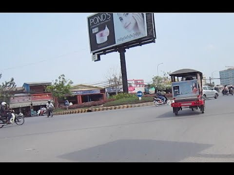 Travelling in Phnom Penh city, Toulkork round a bout, Burger King, bike shop