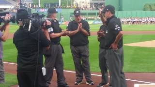 Pirates, fans honor umpire John Tumpane the day after he saves woman's life
