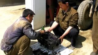 National Farm - Fixing Tractors North Korea DPRK